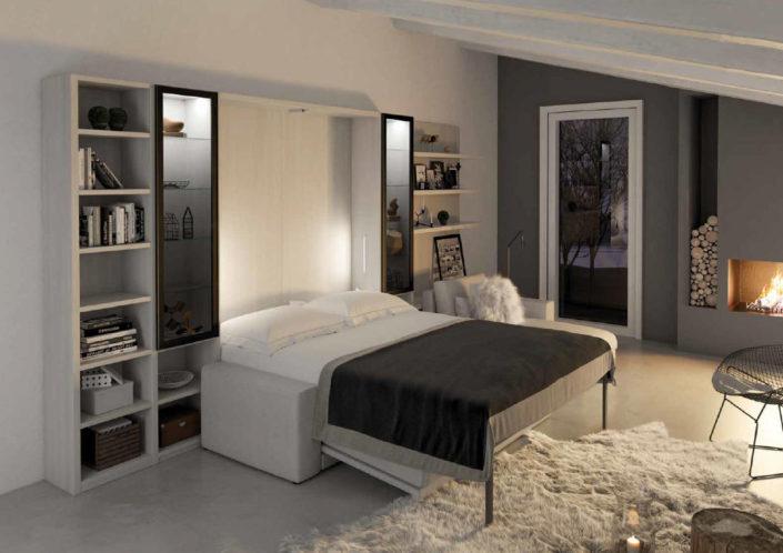 soggiorno con letto e vetrinetta